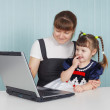 Stock Photo: Mother and child playing with laptop