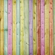Wooden wall painted in colors of rainbow - Stock Photo