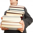 Holding large number of books — Stock Photo