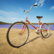 Old-fashioned bicycle on summer beach - Stock Photo