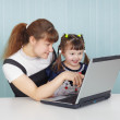 training of child to work on computer in game fo — Stock Photo