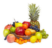 Still life - pineapple and other fruits on white — Stock Photo