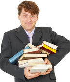 Happy man holding pile of books — Stock Photo