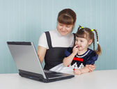 Mother and child playing with laptop — Stock Photo