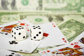 Dices are on cards and money — Stock Photo