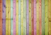 Wooden wall painted in colors of rainbow — Stock Photo