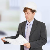 Man in helmet with drawing in hands — Stock Photo