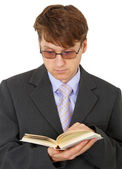 Guy with glasses reading scientific book — Stock Photo