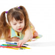 Child draws with color pencils on white — Stock Photo