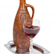 Ancient ceramic bottle with Georgians wine - Stock Photo