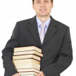 Portrait of man with big pile of books - Stock Photo