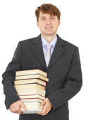 Portrait of man with big pile of books — Stock Photo
