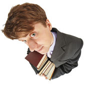 Amusing guy with library books in hands — Stock Photo