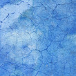 Blue wall covered with cracked plaster - Stock Photo
