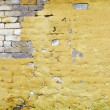 Brick wall with broken plaster - Stock Photo