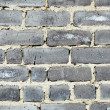 Old moldy gray brick wall - Stock Photo