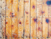 Wall covered with old scratched boards — Stock Photo