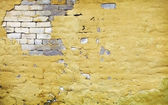 Brick wall with broken plaster — Stock Photo