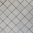 Wall covered with tile - diagonal square texture — Stock Photo