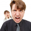 Man angry, he was furious. Woman in horror. - Stock Photo