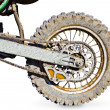 Постер, плакат: Rear wheel motorcycle for trial covered with mud