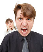 Man angry, he was furious. Woman in horror. — Stock Photo
