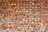 Ancient red brick wall - background — Stock Photo