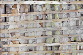 Ruined wall with wooden lattice - background — Stock Photo