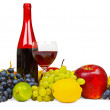 Still life - bottle of red wine and fruits on wh — Stock Photo