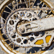 Rear wheel of motorcycle with chain covered with — Stock Photo #3213697