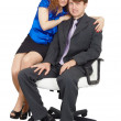 Stock Photo: Young - man and woman sitting on chair