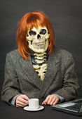 Horrible man - skeleton with red hair drinking c — Stock Photo