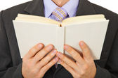 Man in suit reads book — Stock Photo