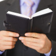 Businessman reading notebook with inscription - Diary — Stock Photo