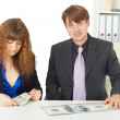 Man and woman have different wages - Stock Photo