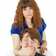 Woman closed mouth to man — Stock Photo