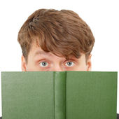 Young man hid his face behind a green book — Stock Photo