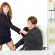 Stock Photo: Womto give mthrashing in office