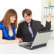Man and woman happy looking at laptop screen — Stock Photo