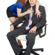 Woman embraces a young man in an office chair — Stock Photo
