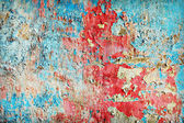 Weathered paint different colors on old wall — Stock Photo