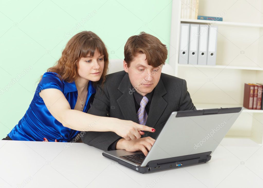 Young - a man and woman working in an office with computer — Stock Photo #3438529