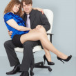 Young woman sitting on lap of a man — Stock Photo