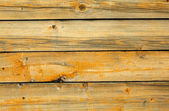 Old battered wall are covered with boards — Stock Photo