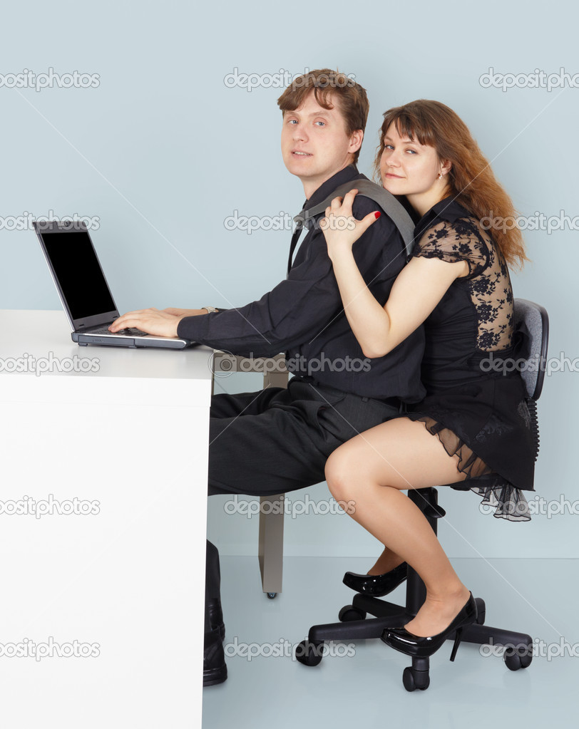 Husband and wife go to surf the Internet using a laptop  Stock Photo #3448471