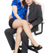 Young couple sitting on office chair — Stock Photo