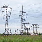 Several high-voltage transmission lines — Stock Photo