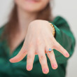 Woman shows new ring with blue gem — Stock Photo