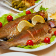 Delicious fried fish on table — Stock Photo