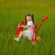 Little girl rides a bicycle on field — Stock Photo